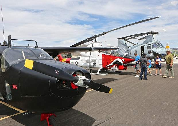 Kids and adults enjoy the static aircraft displays during a special event at the Carson City Airport.