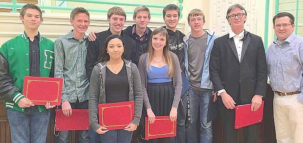 The trustees recognized the 19 member who were selected for the All State Choir at a board meeting. Back row from left are Eric Sabatino, Davis Koenig, Joseph Sorensen, Thomas Robertson, Justice Crowley, Nathan Schank, choir teacher Thomas Fleming and trustee Greg Koenig. Front row from left are Sabrina Jimenez and Alison James. Not pictured are Megan Rosario, Adia Sommer, Megan Housel, Melissa Coblentz, Alex Nelsen, Donald Granger, Eric Sorensen, Keenan Caillouette, Ethan Smith, Dustin Gross and Jacob Moulton.