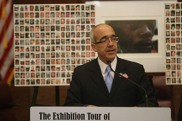 "Senate Majority Leader Mo Denis talks about the ""Always Lost: A Meditation on War"" exhibit at the Nevada Legislature in 2013."