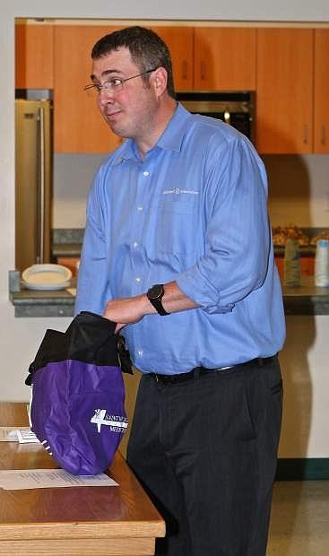 Alzheimer's Association Regional Director Jacob Harmon speaks to Sheriff's Dept. members Thursday evening in Carson City.