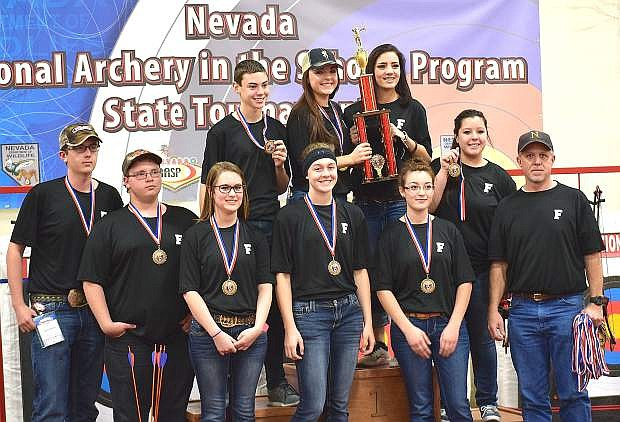 The Greenwave archery club won their third state title in four years last week in Las Vegas. The team from bottom row left to right are Sterling Lee, Brandon Burgess, Emily Mulac, Faith Cornmesser, Lana Quint and coach Dean Schultz. Top row from left are Broder Thurston, Nichole Mariezcurrena, Kayla Biggs and Emily Dixon.