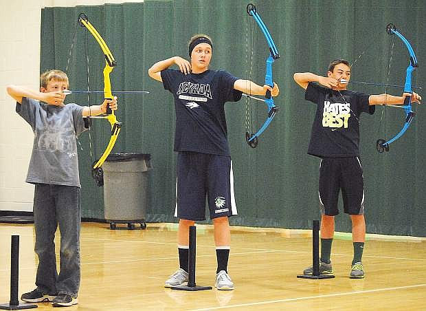 Fallon archers Case Cornmesser, left, Faith Cornmesser, middle, and Broder Thurston will compete at the national archery tournament in Louisville, Ky., on Saturday.
