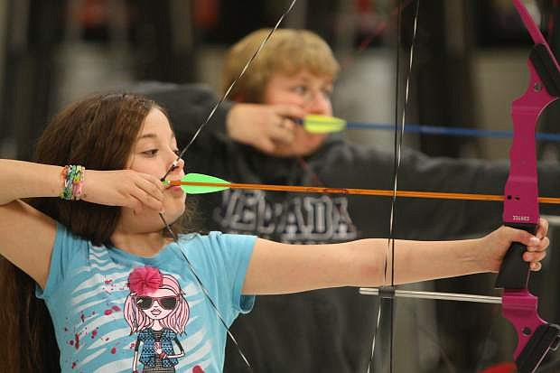 Erica Banks, a fourth grade student at Fritsch Elementary school competes in a statewide archery tournament on Tuesday.