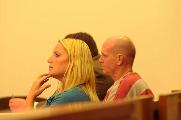 Indian Hills resident David Paul Lane y listens at his preliminary hearing  in Carson City.