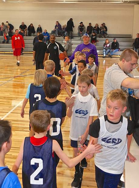 The Bulls and Lakers congratulate each other following a 3rd grade Carson City Park and Rec youth basketball game Saturday at the MAC.
