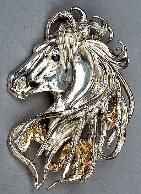 Ghost Horse made of sterling silver, gold and precious stone.