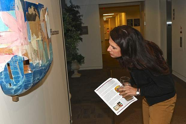 Adriana Fralick admires the art of Jeff Hantman Friday evening at the CCAI Courthouse Gallery.