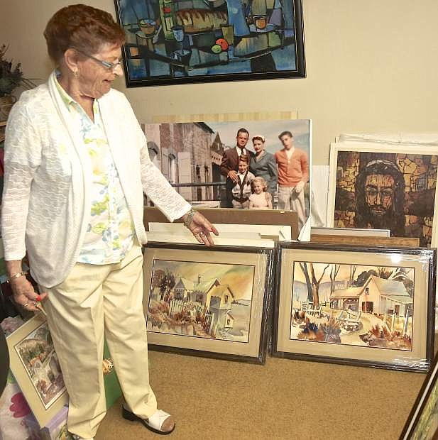 Pat Holub, 93, shows some or her art pieces at her home in Carson City Wednesday.
