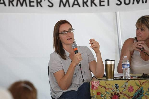 Author Novella Carpenter speaks at the farmer's market in downtown Carson City Saturday.