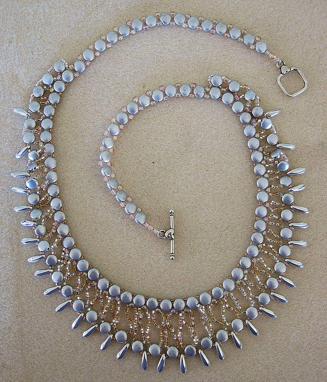 A hand beaded necklace by Suzy Musil.