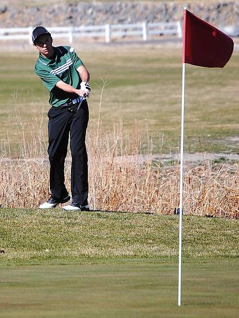 Fallon junior Corbin Waite chips from the rough during Wednesday's Northern Division I-A league tournament in Fernley.
