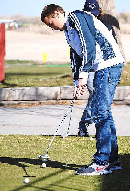 Fallon junior golfer Corbin Waite follows through on a putt during Monday's practice at the Fallon Golf Course.