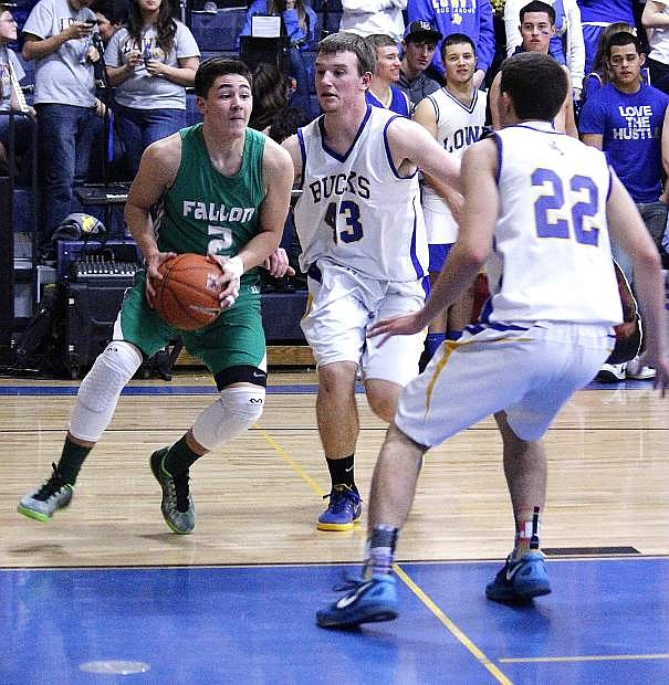 Fallon guard Connor Richardson drives the lane during Saturday's 60-23 loss to Lowry, The Wave rebounded Monday with an 84-47 thumping over Dayton.