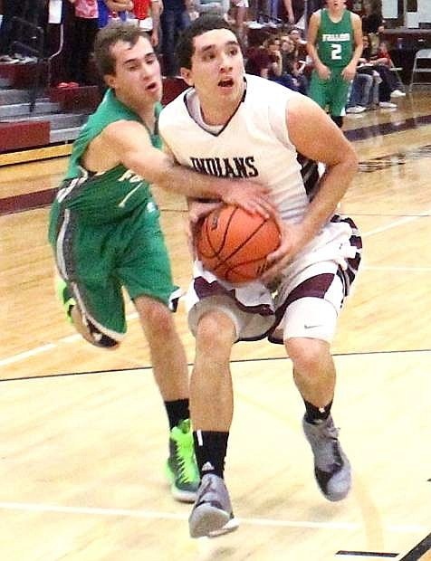 Fallon's Marshall Coverston gets a hand on the ball as Elko's Nathan Klekas attempts to drive to the basket.