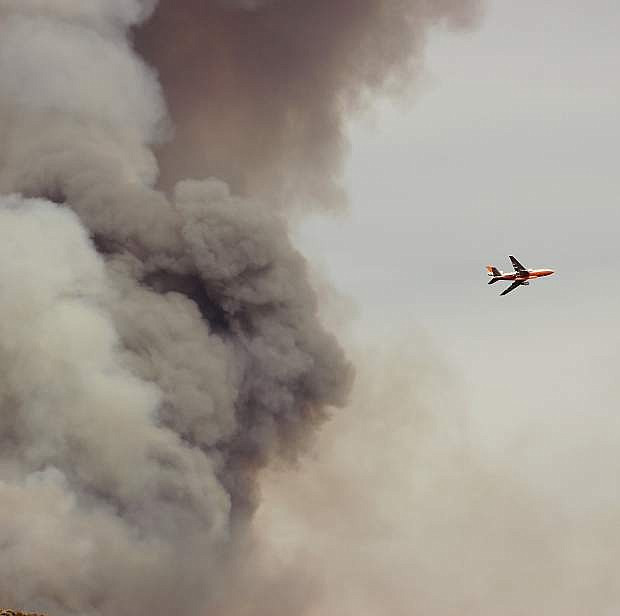 An air tanker circles over the Cold Springs Fire before dropping a load of retardant.