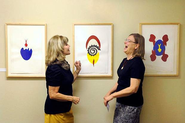 Deb Cash, left, makes artist Carol Brown laugh, while discussing her work, at the BRIC Art 4 exhibition reception on Wednesday inside the Business Resource Innovation Center. The Capital City Arts Initiative exhibit, co-hosted by the Carson City Library, features eight area artists at BRIC, 108 E. Proctor St., and will continue through early September 2014. The exhibit features the work of: Kyle Akins, Megan Berner, Carol Brown, Erik Holland, Melissa Melero, Stephen Reid, Lynn Schmidt and Julia Schwadron.