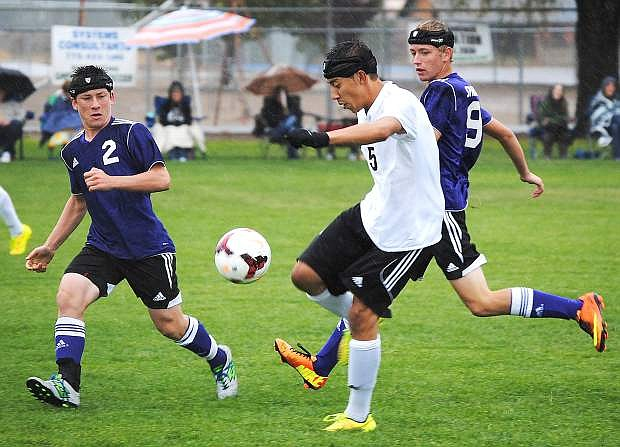 Fallon midfielder Omar Madera looks to pass during the Wave's scoreless tie against Spring Creek on Saturday.