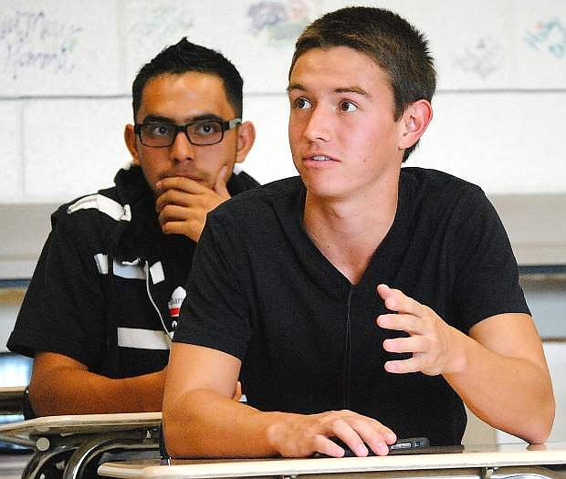 Fallon defender Robby Davis, front, and Miguel Saenzpardo discuss the Wave's upcoming preseason tournament Monday. The team did not practice from Friday through Monday due to smoke from the California wildfires.