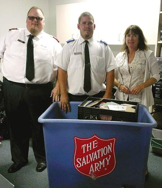 Shown from the left is Lt. Mark Cyr; Matt Carboni, Salvation Army youth pastor; and Peggy Sweetland, special projects coordinator with the Carson City School District.