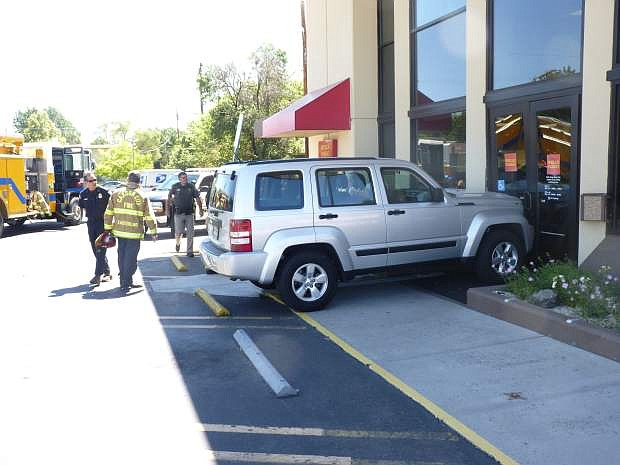 A 78-year-old woman crashed a Jeep 4X4 into the Wells Fargo Bank at 211 N. Stewart Street shortly after 11 a.m. Monday. According to police at the scene, the woman received minor cuts to the hand and arm, but refused treatment. She allegedly accellerated instead of braking. The bank received some damage to the wall next to the front doors, but remained open for business. Customers are advised to use the side door facing Stewart Street.