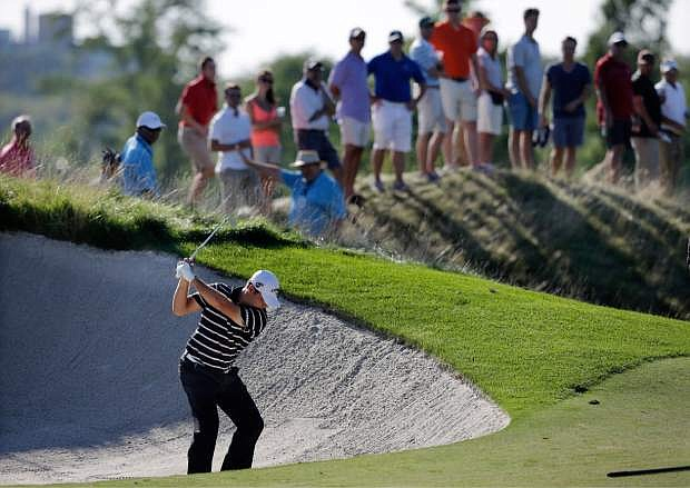 Gary Woodland hits from a trap on the 15th hole during the third round of The Barclays golf tournament Saturday, Aug. 24, 2013, in Jersey City, N.J. (AP Photo/Mel Evans)
