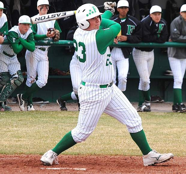 Fallon designated hitter Branden Beeghly smacks a two-run single during the Greenwave's 12-11 win over Spring Creek on Saturday. Beeghly also hit a game-tying two-run double in Saturday's finale as Fallon swept the Spartans.