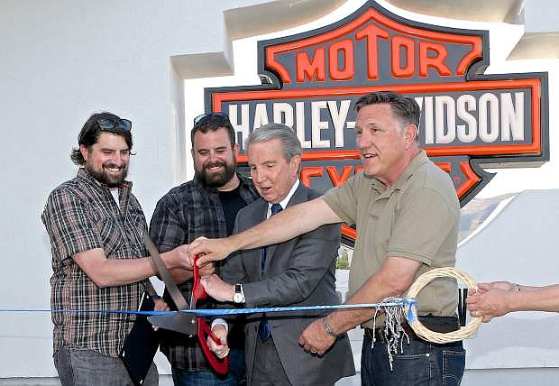 The Hohl brothers along with Carson City Mayor Bob Crowell and Assemblyman P.K. O'Neill cut the ribbon at Battle Born Harley-Davidson's grand opening Thursday. Battle Born is hosting Street Vibrations participants featuring the Cash Only band from 3-6 pm today and live music from 3-7 p.m. with Thee Orbiters on Saturday.