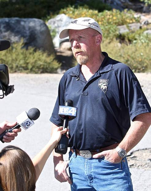 NDOW's Carl Lackey addresses the media after the release of a mother bear and her cub last September.