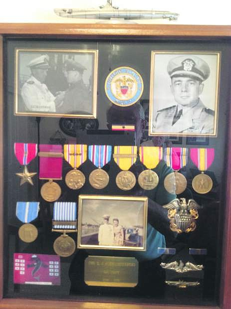 The picture in the upper left is Rear Admiral Lockwood pinning the Bronze Star on Chief Delmar J. Schwichtenberg. The first red ribbon with the vertical blue strip on the left in the top row of ribbons is Del Bronze Star.