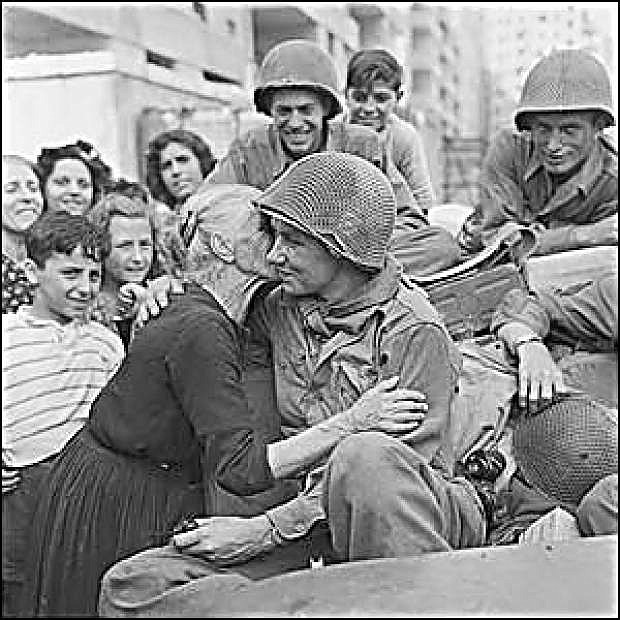 An Italian woman kisses an American G.I. after the liberation of Rome during World War II.