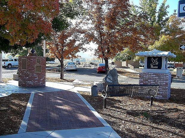 """The Korean War Veterans Memorial Brick walk is pictured on the left and the Korean House, """"Hanok"""" pictured on the right was sculptured in South Korea and shipped to Carson City."""