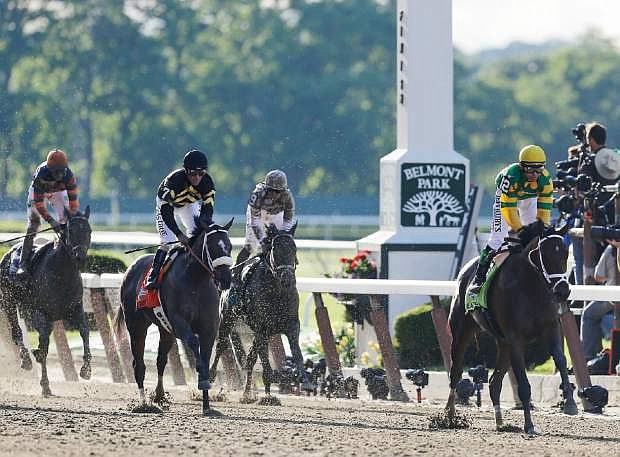 Palace Malice, right, with jockey Mike Smith, right, beats out Oxbow (7), with jockey Gary Stevens, and Revolutionary (9) with jockey Javier Castellano, to win the 145th Belmont Stakes horse race at Belmont Park Saturday, June 8, 2013, in Elmont, N.Y. (AP Photo/Seth Wenig)