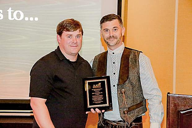 Antique and Amusement Photographers International President Derrick Gillikin presents the Martin & Bertha Glaser Memorial Award to Jeff Mulvihill, owner of instaimage Photography of Northern Nevada.