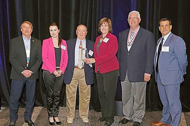 Representatives from Nevada Rural Housing Authority accept awards for excellence in two categories.