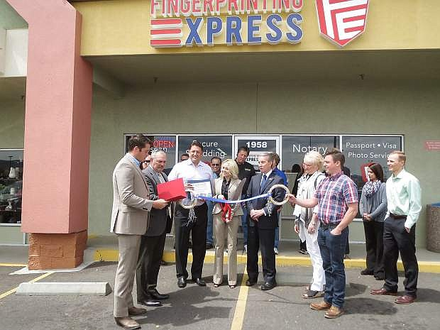 Fingerprinting Express, located on William Street in Carson City, celebrates its ribbon cutting with Mayor Bob Crowell. The store is the only Northern Nevada Livescan fingerprinting vendor approved by the state Department of Education.