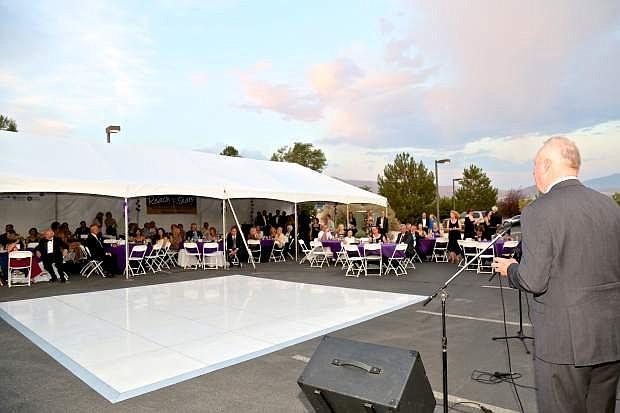 WNC President Chet Burton addresses black tie gala guests Saturday night at the Jack C. Davis Observatory in Carson City.