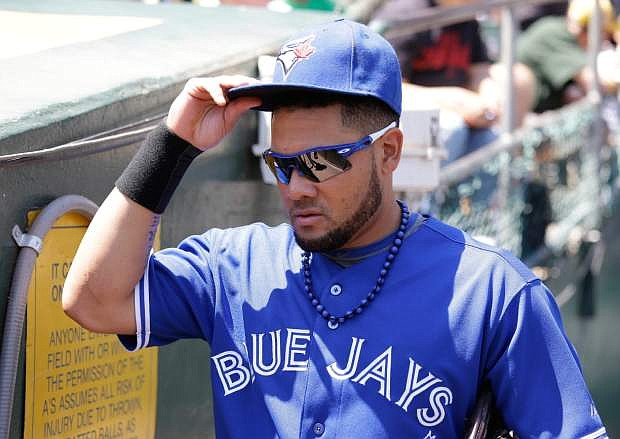Toronto Blue Jays left fielder Melky Cabrera makes his way toward the dugout from the clubhouse before a baseball game against the Oakland Athletics, Wednesday, July 31, 2013, in Oakland, Calif. (AP Photo/Eric Risberg)