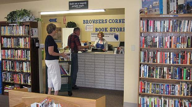 Customers Jan and Bill Bachman buy books from volunteer Sylvia Winters at the Browsers Corner Book Store, which helps fund the Carson City Library.