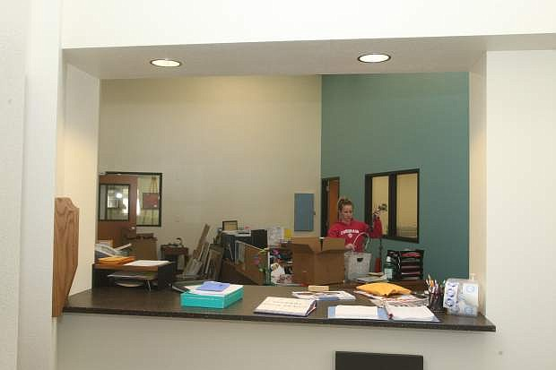 Bordewich-Bray Elementary School office manager Danielle Reinhardt organizes her desk space on Monday after the renovation of the school's front office and entrance.