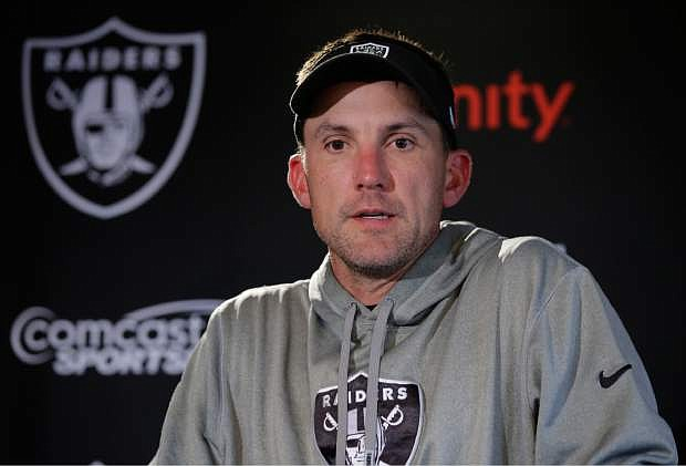 Oakland Raiders head coach Dennis Allen answer a reporter's question during a media conference following a training session at Pennyhill Park, Bagshot, England, Thursday, Sept. 25, 2014. The Raiders will play the Miami Dolphins in an NFL football game at London's Wembley Stadium on Sunday Sept. 28.(AP Photo/Lefteris Pitarakis)