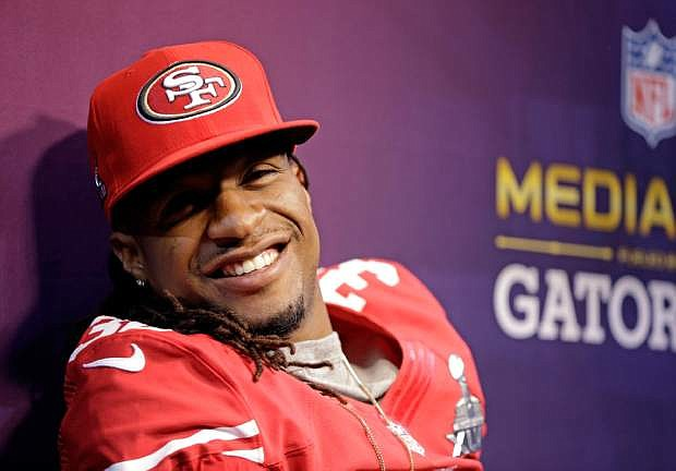 FILE - In this Jan. 29, 2013 file photo, San Francisco 49ers safety Dashon Goldson (38) smiles during media day for the NFL Super Bowl XLVII football game in New Orleans. A person with knowledge of the contract says free agent Goldson has agreed to a $41.25 million, five-year deal with the Tampa Bay Buccaneers. The person spoke on condition of anonymity to The Associated Press on Wednesday, March 13, 2013, because the team had yet to formally announce Goldson's deal.(AP Photo/Mark Humphrey, File)