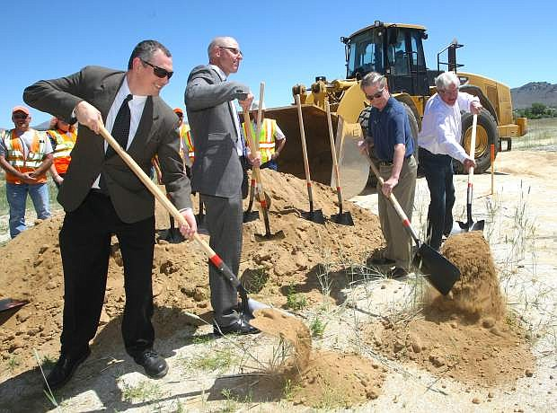 Taking part in a ground breaking ceremony for the final leg of the Carson City Freeway are, from left, Patrick Pittenger, Carson City transportation manager; Bill Hoffman, Nevada Department of Transportation deputy director; Bob Crowell, Carson City mayor and Ron Knecht, state controller.