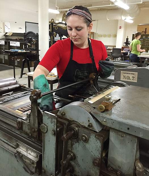 Marie Sophia Sevier Dyer works on a Vandercook press. Dyer is one of 10 students displaying art in Print Project, a display going up at the Community Development Building in Carson City.