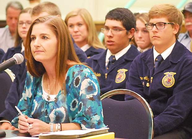 Kristina Moore, CCHS teacher and FFA advisor presents the trustees with a report on the benefits of using the Rio Vista Drive property for the program with support from her students. From right are Blane Merkley, Allysen Olsen, Garrett Archuleta, Moore, Mallory Goodrick and Kiley Woolsey.