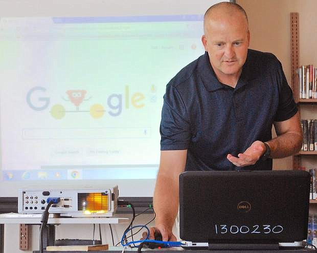 Nate Waite, secondary technology integration coach for Churchill County School District, instructed teachers on Monday about the new Google Chromebooks.