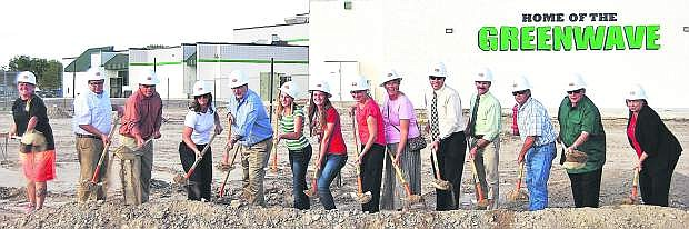 School officials had a Ground Breaking Ceremony Thursday at the site where the auxiliary gym will be built. Trustees, teachers and students were invited to break ground. From left are Chelle Dalager, Greg Koenig, Matt Hyde, Anne Smith, Mayor Ken Tedford, Hannah Isbister, Jordyn Rogers, Kathryn Whitaker, Carmen Schank, Kevin Lords, Rich Gent, Clay Hendrix, Ron Evan and Superintendent Dr. Sandra Sheldon.