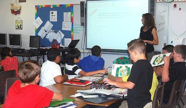 Numa Elementary School Teacher Lisa Solinski instructs her fifth-grade classs during a school day.