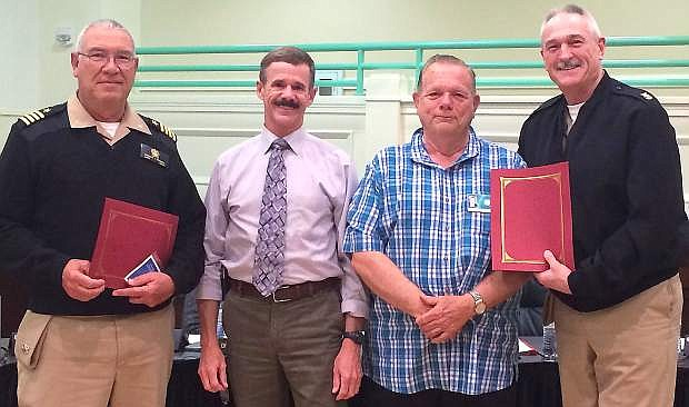 The Churchill County School Board of Trustees recognized Capt. Robert Kermen, Senior Naval Science Instructor, and Command Master Chief Donn Sheldon, Naval Science Instructor for their outstanding work with the Navy JROTC. From left are Kermen, trustee Rich Gent, President Ron Evans, and Sheldon.