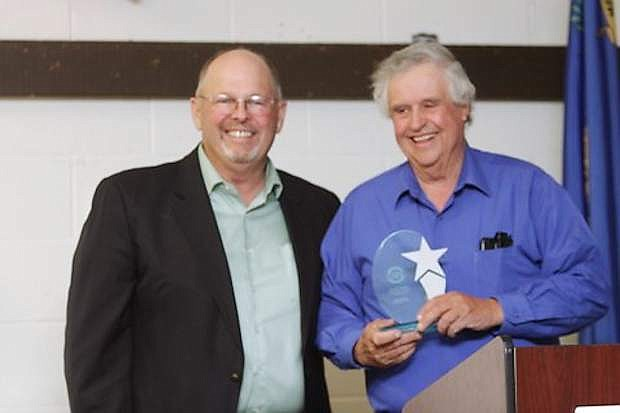 Commissioner Pete Olsen, left, stands with Rick Lattin, who received the Godfather of CEDA Award.