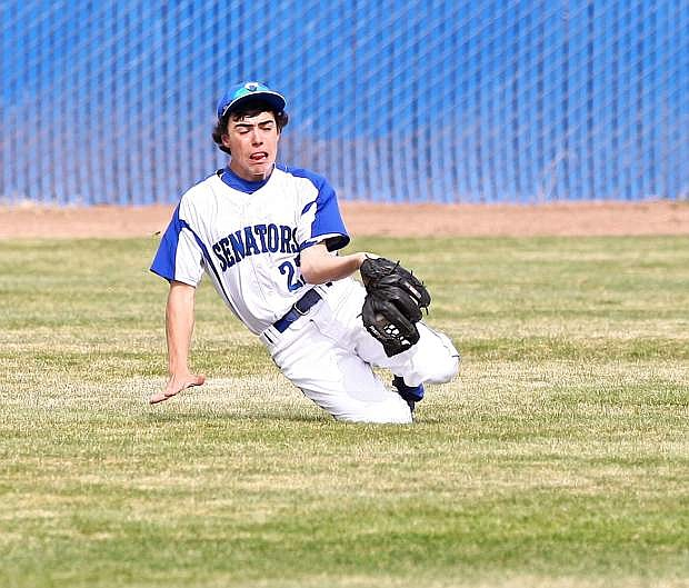 Right fielder Cody Azevedo snags a short fly ball during a game last season.